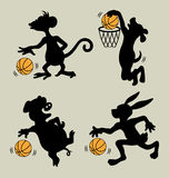 Animal playing basketball silhouettes Royalty Free Stock Photos
