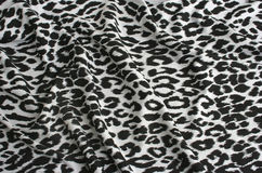 Animal print on fabric. White leopard, tiger.  Look at my gallery for more backgrounds and textures Stock Images