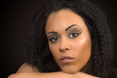 Animal print makeup. Beauty portrait about black woman with animal print eye shadow Stock Image
