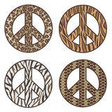 Animal Print Peace Symbols. Vector collection of four animal print peace symbols: Leopard, Tiger, Zebra and Snake Royalty Free Stock Photos