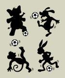 Animal que juega siluetas del fútbol Fotografía de archivo