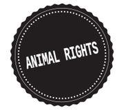 ANIMAL-RIGHTS文本,在黑贴纸邮票 库存图片