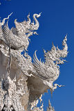 Animal sculptures on roof at wat rong khun Stock Photography