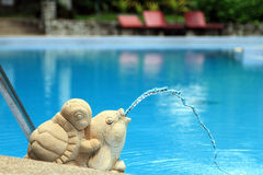 Animal sculptures spraying water in a swimming pool Stock Photography