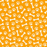Animal seamless  pattern of paw footprint and bone Royalty Free Stock Photography