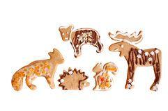 Animal-shaped cookies. Isolated animal-shaped cookies with honey, cinnamon, chocolate, orange zest and frosting topping Royalty Free Stock Image