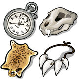 Animal skull, skin, necklace of fangs and timer Royalty Free Stock Photography