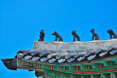 Animal statues on temple roof. Unique animal statues on temple roof with blue sky background stock photo