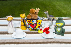 Animal Tea Party. This is a shot of animal friends getting together for a tea party.I just love the colourful tea pot royalty free stock image