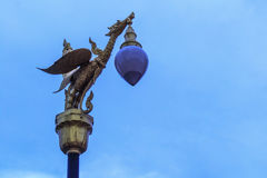 Animal in thai fairy tale. Statue on electricity post Royalty Free Stock Photo