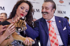 Animal trainer Karina Bagdasarova with tiger cub Stock Image