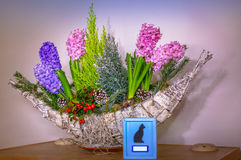 Animal urn with flowers Stock Images