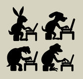 Animal using laptop silhouettes Royalty Free Stock Photos
