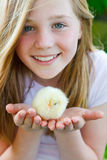 Animal welfare. Cute girl holding a baby chicken Royalty Free Stock Photography