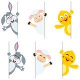 Animales de Pascua que están al acecho detrás de bandera Fotos de archivo