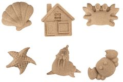 Animali e giocattoli modellati della sabbia Immagini Stock