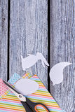 Animalistic figures cut from paper. Scissors on colorful paper sheets. Easter handmade decor royalty free stock images