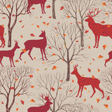 Animals in autumn forest pattern. Fall leaves and trees background Stock Images