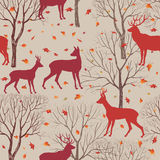 Animals in autumn forest pattern. Fall leaves and trees background Royalty Free Stock Images