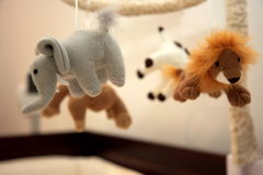 Animals on baby mobile. Details of soft toy animals on baby mobile, focus on elephant Royalty Free Stock Photo
