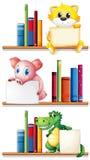 Animals and books on bookshelf Royalty Free Stock Photography