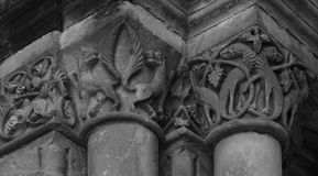 Animals on the capital posing. Shot in black and white, detail on the sculpture on facade on the capital of this historic church representing some animals. Set Royalty Free Stock Photos