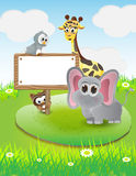 Animals cartoon with blank text box and nature background Royalty Free Stock Photos