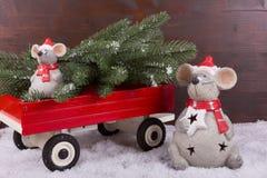 Animals Christmas with christmas tree and trailer Stock Photos