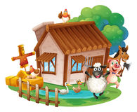 Animals and cottage Stock Image