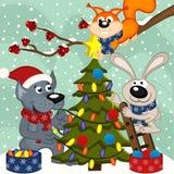 Animals decorating Christmas tree Royalty Free Stock Image