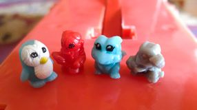 Many small doll animal place on the red plastic base stock photography