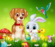 Animals and Easter eggs on green grass Royalty Free Stock Image