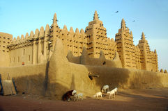 Animals In Front Of The Djenne Mud Mosque Royalty Free Stock Images