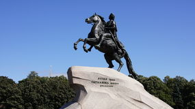 Animals, a man on horseback, a statue, strongly Royalty Free Stock Photos