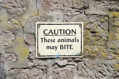 Animals may bite warning sign at zoo safari park royalty free stock photo