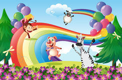 Animals playing at the hilltop with a rainbow stock illustration