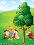 Animals reading under the tree at the hilltop Royalty Free Stock Photography
