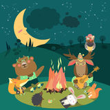 Animals resting around bonfire Royalty Free Stock Photo