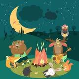 Animals resting around bonfire Royalty Free Stock Photo