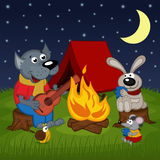Animals resting around bonfire Stock Photo