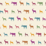 Animals silhouette seamless pattern. Wildlife tiled textured bac Royalty Free Stock Photo