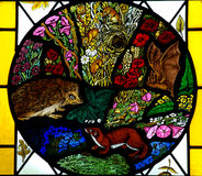 Animals in stained glass. Photo of a stained glass window with animals Stock Photos