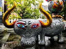 Animals stand still in city center Washington DC. The Chinese Artist design this lovely symbol animal of colorful statues stock photography