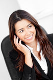 Animated asian businesswoman talking on phone Stock Photo