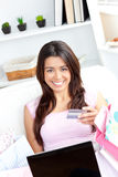 Animated asian woman holding a card and smiling Stock Photography