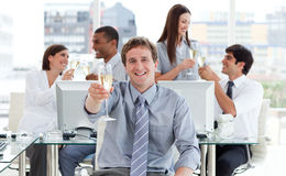 Animated business team drinking champagne Stock Photos