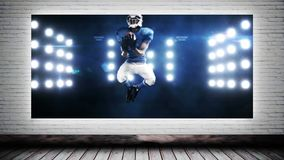 Canvas Football Video. Animated Canvas against brick wall background showing football player catching football against lights stock video footage