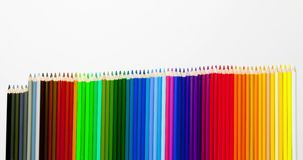 Animated clip from colored pencils - adding, moving up and shrinking multicolor set in row stock video footage