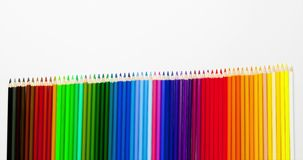 Animated clip from colored pencils - adding and shrinking multicolor set in row stock video