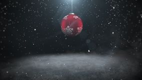 Animated close up white snowflakes and red balls on dark background stock illustration